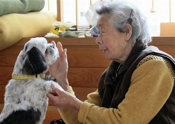 elderly woman with her pet dog