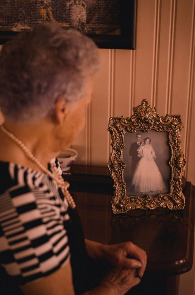 edna looking at picture of her wedding day